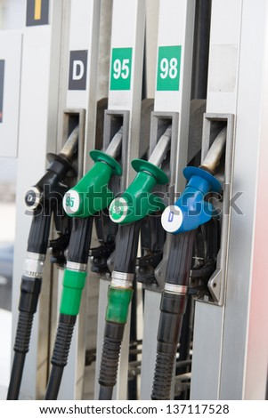 Image of detail of hoses of petrol pump at a gas station, selective focus #137117528