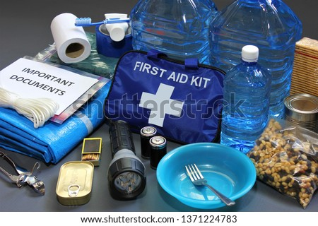 Prepare in advance for a natural disaster by putting together important items that will help you survive.Water,food,shelter,light source,first aid kit are just a few of the items needed to survive. Royalty-Free Stock Photo #1371224783