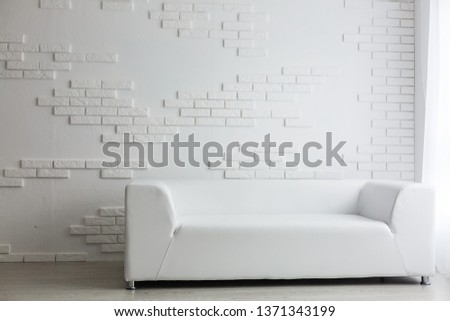 nterior of the living room of the hotel. Beautiful living room with white sofa. White Concept Living Room Interior. Modern bed room interior in Luxury villa. White colours, big window #1371343199