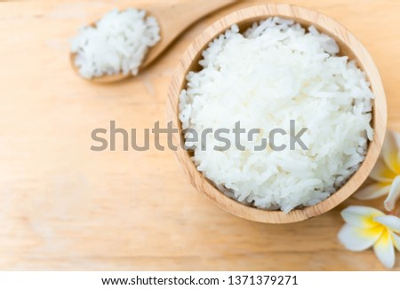 Close up white rice in wooden bowl with spoon, healthy food, selective focus #1371379271