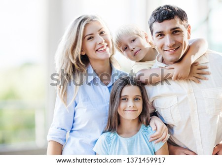 Beautiful smiling Lovely family indoors #1371459917