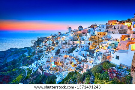 Church of Santorini. Fira town on Santorini island, Greece. Incredibly romantic sunset on Santorini. Oia village in the morning light. Amazing sunset view with white houses. Island of lovers. Postcard #1371491243