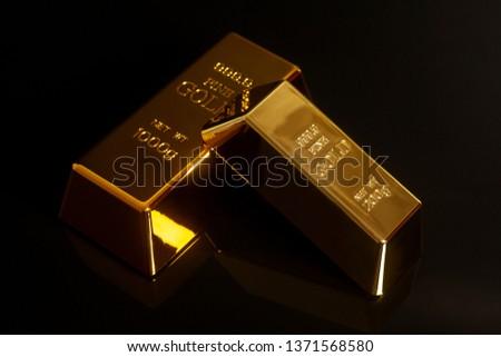 Gold bullions on black #1371568580