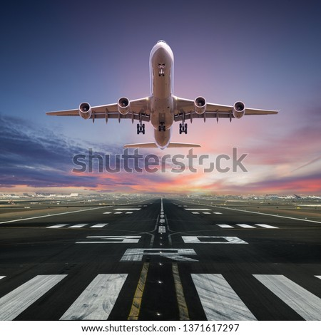 Airplane taking off from the airport, front view. #1371617297