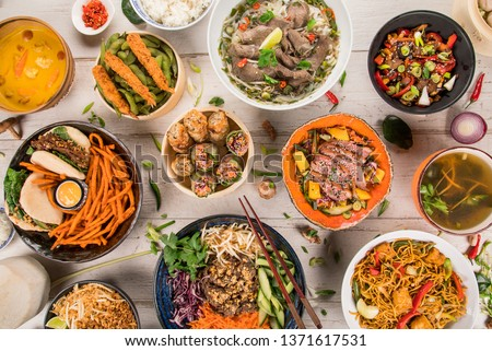 Asian food background with various ingredients on rustic wooden background , top view. Vietnam or Thai cuisine. #1371617531