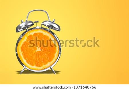 Layout fresh orange slice alarm #1371640766