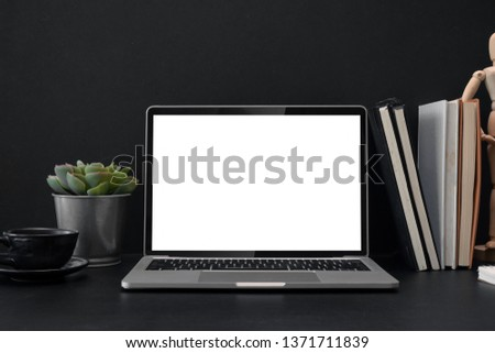 Laptop screen isolated on a desk in office #1371711839