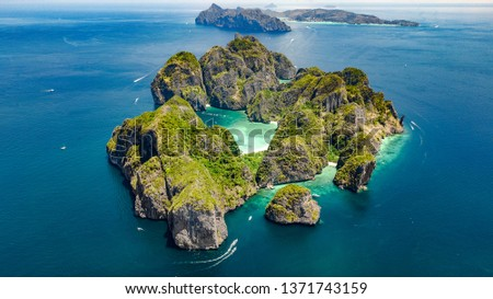 Aerial drone view of tropical Ko Phi Phi island, beaches and boats in blue clear Andaman sea water from above, beautiful archipelago islands of Krabi, Thailand #1371743159