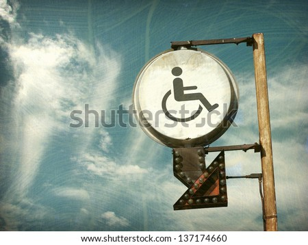 aged and worn vintage photo of  handicap sign