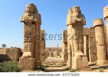 Statues in Karnak Temple, Egypt. Karnark is the biggest temple in Luxor city, Egypt #137176241