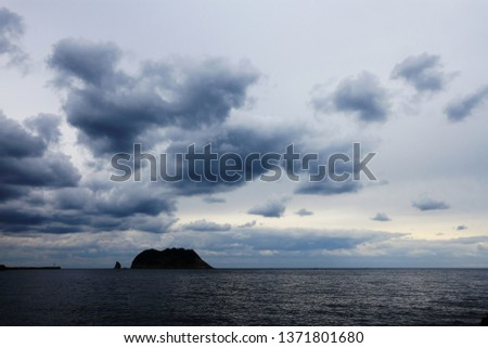 island with cloudy sky  #1371801680