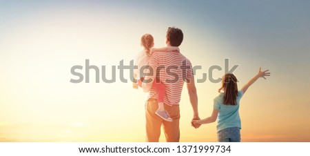 Happy loving family. Father and his daughters children playing and hugging outdoors. Cute little girls and daddy.  #1371999734