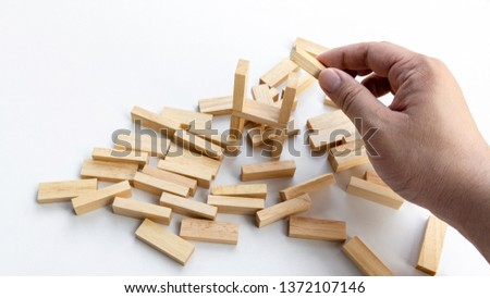 A Man try to rebuild assembly wooden block again after broken Royalty-Free Stock Photo #1372107146