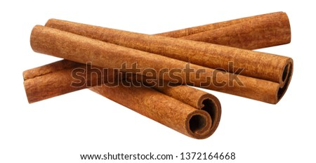 Cinnamon sticks, isolated on white background Royalty-Free Stock Photo #1372164668