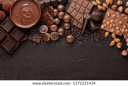 Chocolate candy box / Assortment of fine chocolates in white, dark, and milk chocolate and a bowl of melted chocolate #1372221434