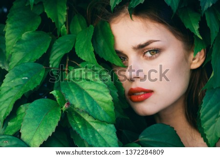 beautiful woman with make up on face red lips green leaves #1372284809