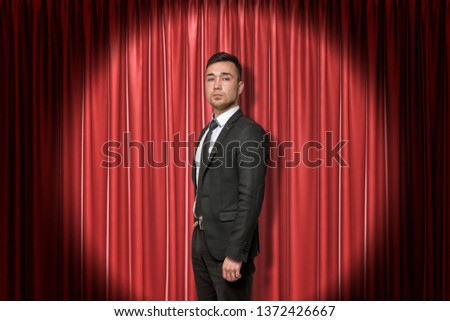 Young businessman on red stage curtains background. Digital art. Fame and glory. Business and commerce. #1372426667