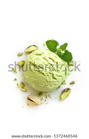 Pistachio Ice Cream isolated on white background, top view. Green pistachio gelato with pistachio nuts and mint. #1372460546