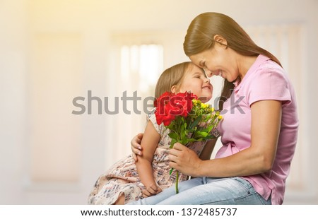 Happy Mother and daughter hugging #1372485737