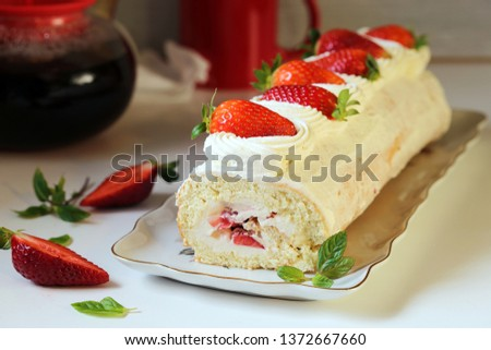 Biscuit roll with cream and strawberry #1372667660