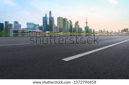 Empty Asphalt Road Through Modern City of Shanghai, China #1372796858
