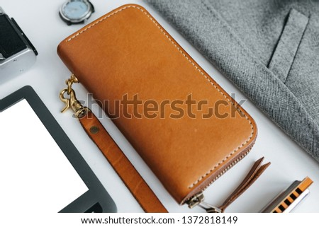 Leather goods with jacket and e-book on a white background Royalty-Free Stock Photo #1372818149