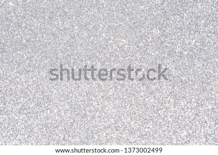 sparkles of silver glitter abstract background #1373002499