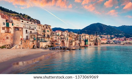 Attractive evening cityscape of Cefalu town. Amazing sunset on Mediterranean sea, Sicily, Italy, Europe. Traveling concept background. #1373069069