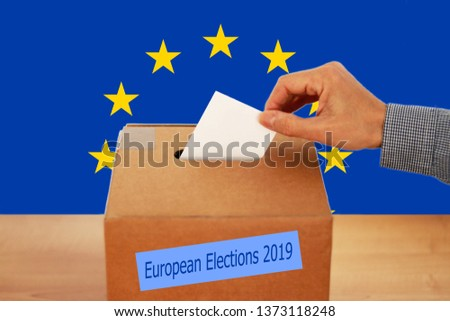 2019 European Union Elections - A hand putting a vote in the ballot box #1373118248