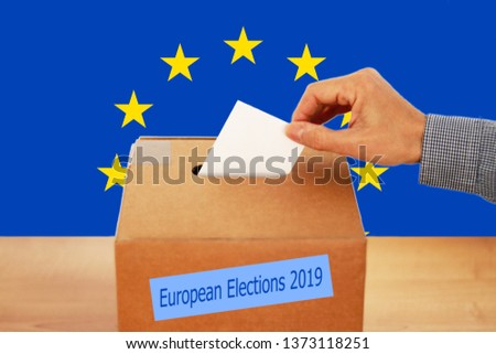 2019 European Union Elections - A hand putting a vote in the ballot box #1373118251