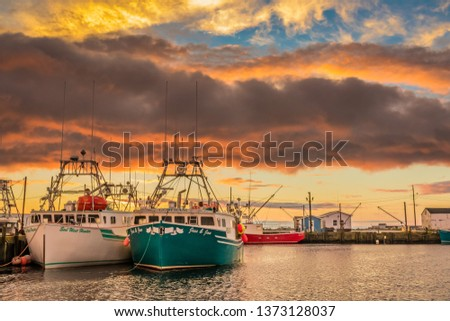 Clarks Harbour, Nova Scotia, Canada, April 28 2019; Lobster fishing boats arrive to home port wharf after a long day of pulling traps and gear. #1373128037