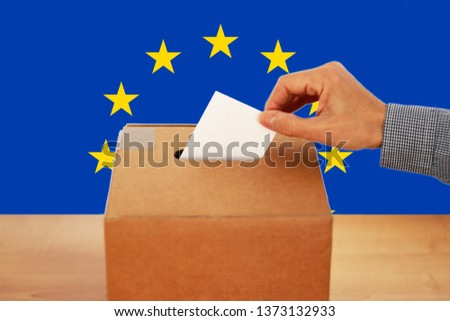 2019 European Union Elections - A hand putting a vote in the ballot box #1373132933