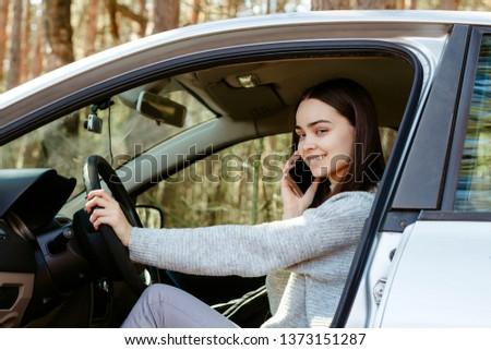 female driver talks on the phone #1373151287