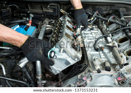 The auto mechanic deconstructs the internal combustion engine #1373153231