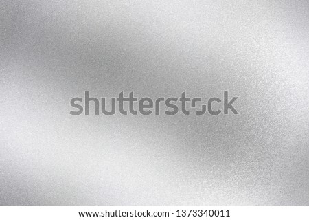 Shiny silver foil wave metal , abstract texture background Royalty-Free Stock Photo #1373340011