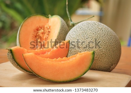 Whole and sliced of Japanese melons,honey melon or cantaloupe (Cucumis melo) on wooden table background.Favorite fruit in summer.Food,Fruits or healthcare concept. #1373483270