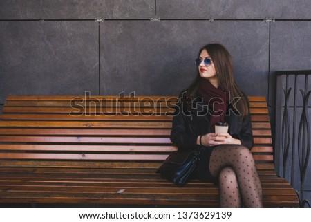 beautiful woman walking in the city enjoying delicious coffee #1373629139