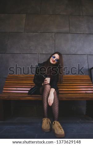 beautiful woman walking in the city enjoying delicious coffee #1373629148