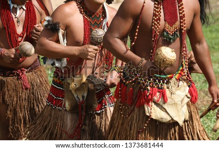 Brazilian Indians of the Pataxó ethnic group during their daily activities of dance, hunting and fishing Royalty-Free Stock Photo #1373681444
