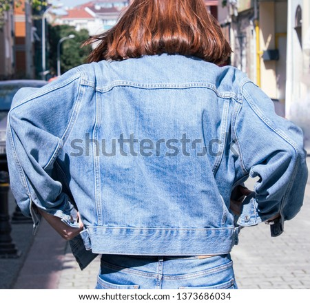 template and mockup blank blue denim jacket posing against street background, blank mockup for print store Royalty-Free Stock Photo #1373686034