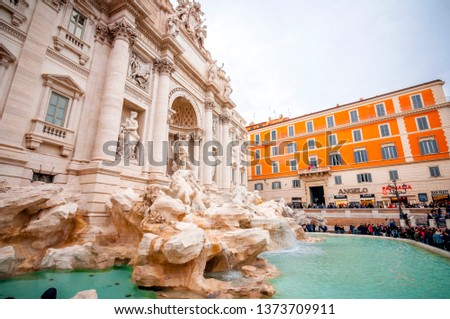Rome, Italy - April 3, 2019: Frontal view of the famous Trevi Fountain or Fontana di Trevi at Piazza Trevi, Rome. Built in 1762, designed by Nicola Salvi. #1373709911