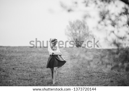beautiful young lady walking in wheat fields during sunset, wear summer pink dress and head flower wreath #1373720144