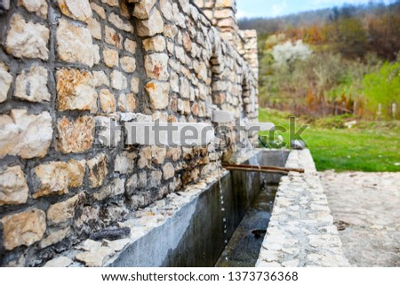 a beautifully constructed water source of good quality stone.-Image #1373736368
