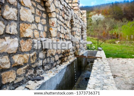 a beautifully constructed water source of good quality stone.-Image #1373736371