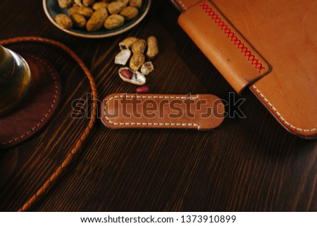 Leather notebook in the bar with beer and nuts on a wooden table, Flat Lay #1373910899