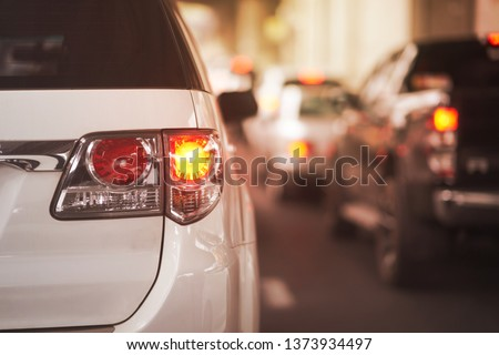 Rear lamp signals for turn of car on street Royalty-Free Stock Photo #1373934497