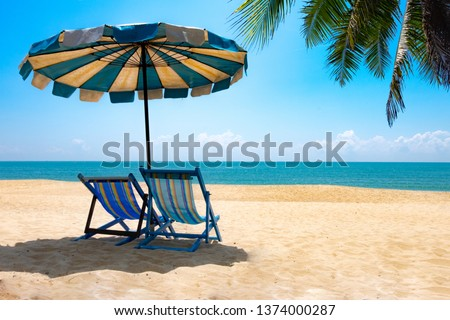 View of two chairs and parasols on the beach, sky Summer vacation concept Consists of travel websites #1374000287