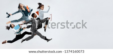 Happy businesswoman and african man dancing in motion isolated on white studio background. Flexibility and grace in business. Human emotions concept. Office, success, professional, happiness #1374160073
