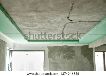 interior of modern building under renovation. Construction on the ceiling.  #1374246356