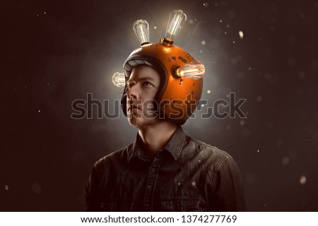 Young man with light bulb helmet #1374277769